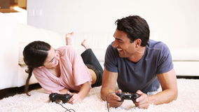 Couple spending time together in their living room Royalty Free Stock Images
