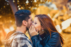 Couple spends time in the autumn park. Young couple spends time in the autumn park Royalty Free Stock Photography