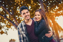 Couple spends time in the autumn park. Young couple spends time in the autumn park Royalty Free Stock Photo