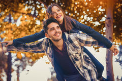 Couple spends time in the autumn park Stock Images