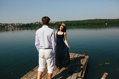 Couple spends time on the wooden pier Royalty Free Stock Images