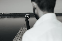 Couple spends time on the wooden pier Stock Photography