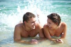 Couple splashing Stock Image