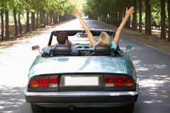 Couple in sports car Stock Photo