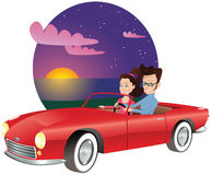 Couple in sports car at sunset Royalty Free Stock Images
