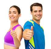 Couple In Sports Wear Gesturing Thumbs Up Royalty Free Stock Photo