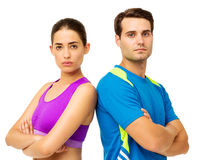 Couple In Sportswear Standing Arms Crossed Stock Photo