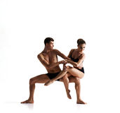 Couple of sporty ballet dancers in art performance Royalty Free Stock Images