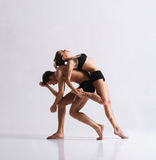 Couple of sporty ballet dancers in art performance Stock Images