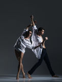 Couple of sporty ballet dancers in art performance. Royalty Free Stock Photography