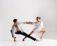 Couple of sporty ballet dancers in art performance. Stock Images