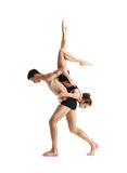 Couple of sporty ballet dancers in art performance. Royalty Free Stock Images