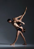 Couple of sporty ballet dancers in art performance. Royalty Free Stock Photos