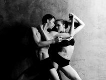 Couple of sporty ballet dancers performing in a studio Stock Photo