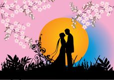 Couple and spring flowers Stock Photos