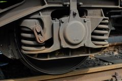 Couple of springs and wheels on train car royalty free stock photography