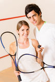 Couple of squash players Royalty Free Stock Images