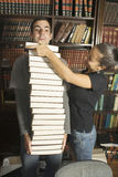 Couple Stacking Books - Vertical Royalty Free Stock Photo
