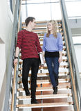 Couple in the stairs Royalty Free Stock Photos