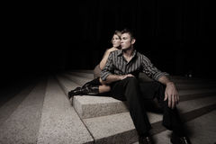 Couple on stairs at night Royalty Free Stock Photography