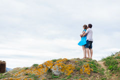 Couple stand on the hill Stock Image
