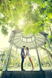 Couple stand. In pavilion and them  ready to kiss Royalty Free Stock Photo