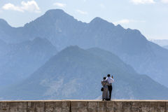 A couple stand on the sea wall at the old Roman harbour in Kaleici in Antalya, Turkey. Stock Photography