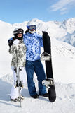 Couple stand with snowboard Stock Photography