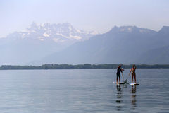 Couple on stand up paddle board at Lac Leman near Montreux, Switzerland Royalty Free Stock Image