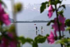 Couple on stand up paddle board at Lac Leman near Montreux, Switzerland Royalty Free Stock Photography