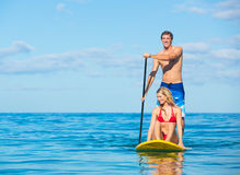 Couple Stand Up Paddle Surfing In Hawaii Royalty Free Stock Images