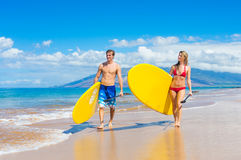 Couple Stand Up Paddle Surfing In Hawaii. Beautiful Tropical Ocean, Active Beach Lifestyle Royalty Free Stock Photography