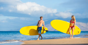 Couple Stand Up Paddling in Hawaii Royalty Free Stock Photo