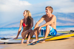Couple Stand Up Paddling in Hawaii Royalty Free Stock Photography