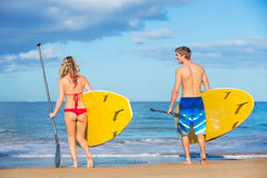 Couple Stand Up Paddling in Hawaii Stock Photo