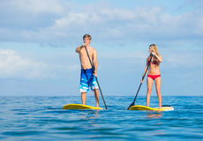 Couple Stand Up Paddling in Hawaii Stock Image