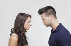 Couple standing against each other Royalty Free Stock Photography