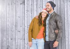 Couple standing against wooden background Stock Photography