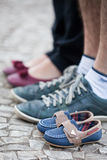 Couple standing along small shoes Royalty Free Stock Images