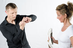 Couple standing and arguing with shoes Stock Image