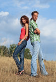 Couple standing back to back Stock Photography