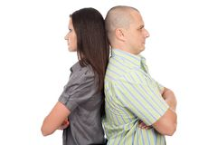 Couple standing back to back Royalty Free Stock Images