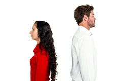 Couple standing back to back after arguing Royalty Free Stock Images