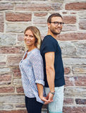 Couple Standing Back to Back and Holding Hands Stock Image