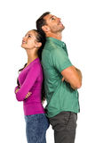 Couple standing back to back land looking up Stock Photography