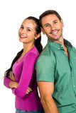 Couple standing back to back looking at camera Royalty Free Stock Photography