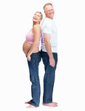 Couple standing back to back over white background Stock Photography