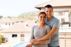 Couple standing balcony Stock Images