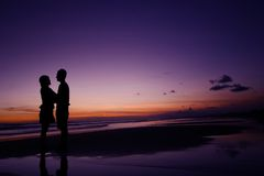 Couple Standing on the Beach Stock Image