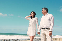 Couple standing at the beach Royalty Free Stock Photography